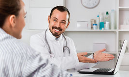 Woman having consultation with male doctor in hospital Royalty Free Stock Photos