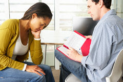 Woman Having Counselling Session. With Male Counsellor Royalty Free Stock Photography