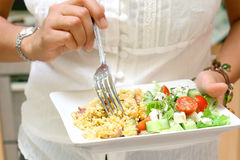 Woman having couscous Royalty Free Stock Images