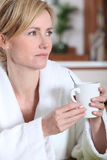 Woman having a cup of coffee Stock Photo
