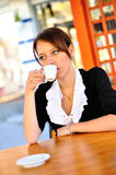 Woman having a cup of coffee at the lunch Stock Images