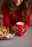 Woman having cup of hot chocolate and Christmas sweets. Closeup Stock Photography