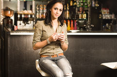 Woman having a cup of hot coffee. Stock Image