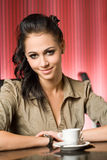 Woman having a cup of hot coffee. Stock Images