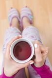 Woman having a cup of tea Stock Photo