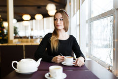 Woman having cup of tea Royalty Free Stock Photography