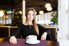 Woman having cup of tea Stock Photography