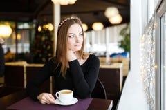 Woman having cup of tea Stock Photo