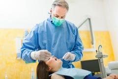 Woman having a dental treatment Stock Photography