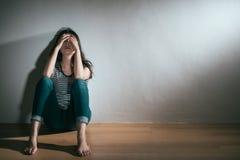 Woman having depression bipolar disorder trouble. Elegant young woman having depression bipolar disorder trouble feeling confusion sitting on wooden floor stock photo