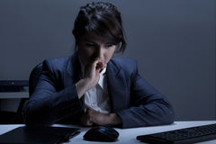Woman having depression at work Royalty Free Stock Photos