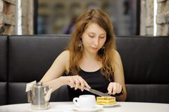 Woman having dessert in a cafe Stock Photo