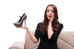 The woman having difficult choice between shoes Stock Image