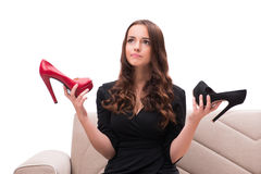 The woman having difficult choice between shoes Royalty Free Stock Images