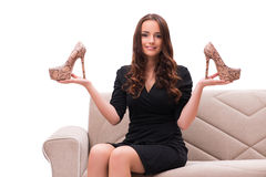 The woman having difficult choice between shoes Royalty Free Stock Photos