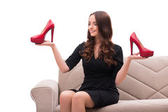The woman having difficult choice between shoes Royalty Free Stock Photo