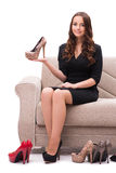 The woman having difficult choice between shoes Stock Photo