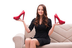 The woman having difficult choice between shoes Royalty Free Stock Photography