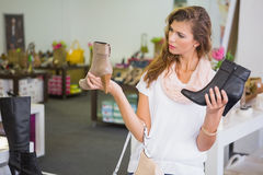 Woman having difficulties choosing shoes Stock Image