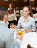 Woman having dinner with guy Stock Image