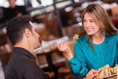 Woman having dinner with her boyfriend Royalty Free Stock Photos