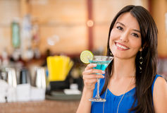 Woman having a drink Stock Images