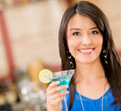 Woman having a drink Royalty Free Stock Photography