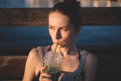 Woman having drink outdoor Stock Photography