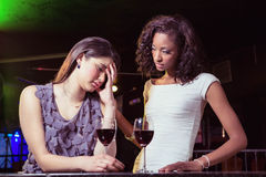 Woman having drinks and comforting her depressed friend Stock Photography