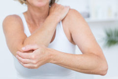 Woman having elbow pain Royalty Free Stock Images