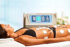 Woman having electrical lymphatic drainage. Young woman having electrical lymphatic drainage in spa Royalty Free Stock Photos