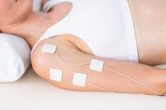 Woman having electrotherapy Stock Photos