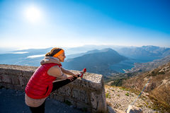 Woman having exercise on the mountain road Royalty Free Stock Image