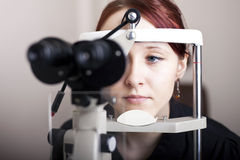 Woman having eye exam Royalty Free Stock Photography