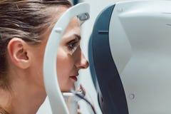 Woman having eyesight test using modern refractometer Royalty Free Stock Photos