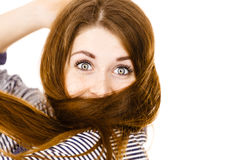 Woman having face covered with her brown hair Royalty Free Stock Photos