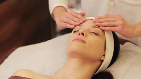 Woman having face and head massage at spa stock footage