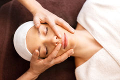 Woman having face and head massage at spa Stock Photo