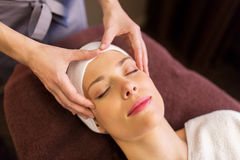 Woman having face and head massage at spa Stock Photos