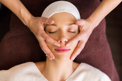 Woman having face and head massage at spa Royalty Free Stock Image