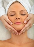 Woman having a face massage Stock Images