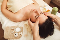 Woman having face massage at salon. Massage Spa Body Relax Rest Treatment Pleasure Beauty Health Care Vacation Resort Concept Stock Image