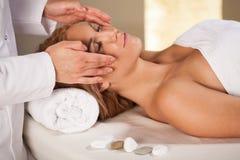 Woman having face massage Royalty Free Stock Photos