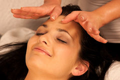 Woman having face massage treatment in wellness. Center Royalty Free Stock Image