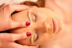 Woman having face massage treatment in wellness Stock Photo