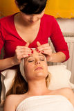 Woman having face skin treatment in wellness Royalty Free Stock Photos