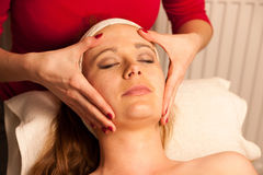 Woman having face skin treatment in wellness Royalty Free Stock Photo