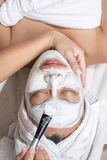 Woman having facial mask at beauty salon Stock Photos