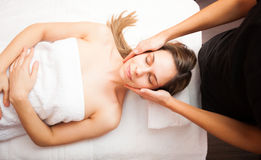 Woman having a facial massage Royalty Free Stock Photos