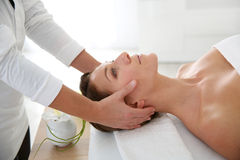 Woman having a facial massage Stock Photos